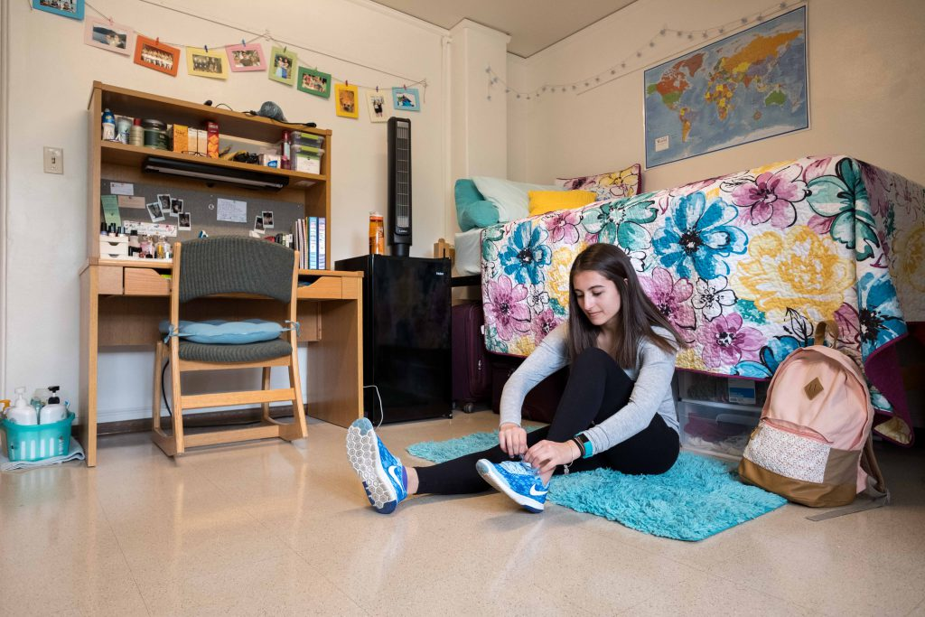 A student in her residence hall room